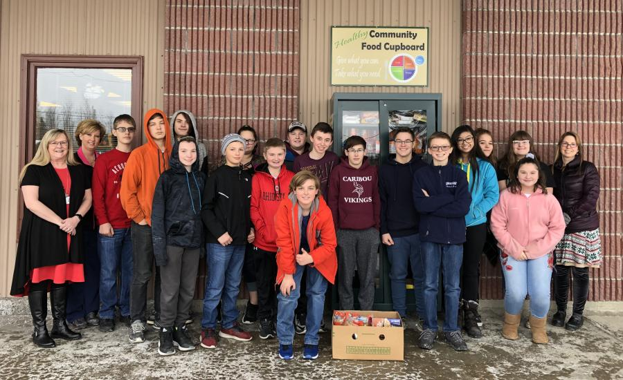 Caribou Middle School 8th Graders Fill Pines Health Services Community Cupboard With Non Perishable Food